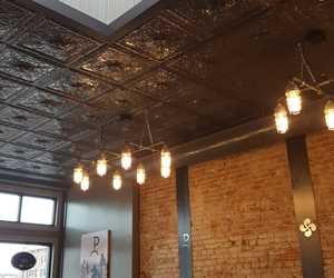 Historic pressed tin ceiling and skylight at Ogi Deli